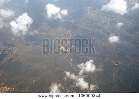 View of clouds and the earth from a plane board.