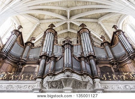BORDEAUX FRANCE - 17 JULY 2015 - The magnificent beautifully detailed pipe organ inside the gothic style Bordeaux Cathedral (Cathedrale Saint-Andre de Bordeaux)