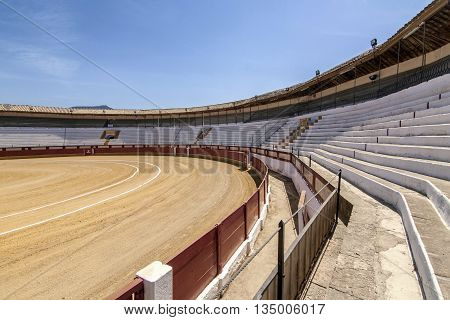 Cabra Spain - September 5 2010: Bullring of Cabra is based on a popular architecture being built with masonry brick and wood debuted as a bullfighter on April 16 1933 Sunday of resurrection the Bullfighter Manuel Rodríguez