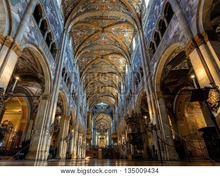 PARMA ITALY - APRIL 27 2016: 12th-century Romanesque Parma cathedral filled with Renaissance art. Its ceiling fresco by Correggio is considered a masterpiece of Renaissance fresco work.
