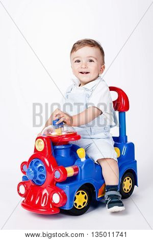 baby boy playing with a toy truck