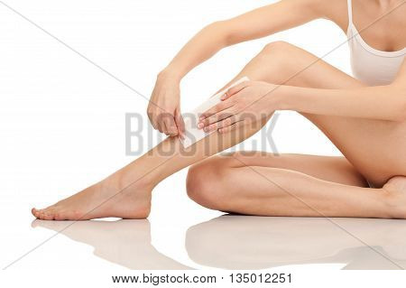 Depilation sexy female legs with waxing isolated on white background