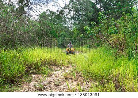 Man In Nature Enjoying A Off Road Quad Bike