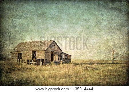 old abandoned homestead on eastern Colorado prairie, grunge and gritty texture picture finish