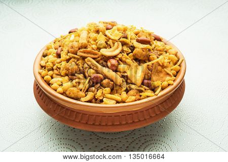 Traditional indian deep fried salty dish - chivda or mixture or farsan or farsaan made of gram flour and mixed with dry fruits poster