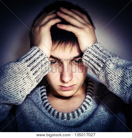 Vignetting Photo of Stressed Young Man by the Wall