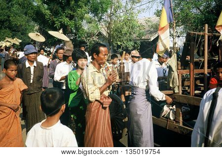 PAGAN / MYANMAR - CIRCA 1987: A man plays a wooden flute at a Buddhist parade in Pagan during a holiday.