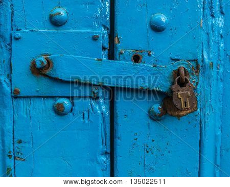 Vintage Sturdy Blue Wooden Door With Heavy Metal Lock