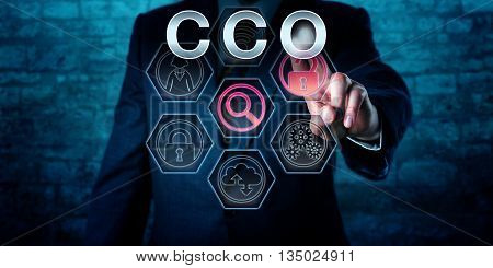 Torso of a male corporate executive touching CCO on an interactive virtual control screen monitor. Business and IT concept for Chief Compliance Officer regulatory compliance issues and governance.