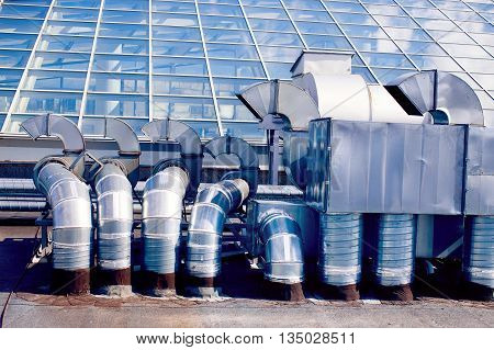 ventilation system on the roof. ventilation pipes on a background of a glass roof