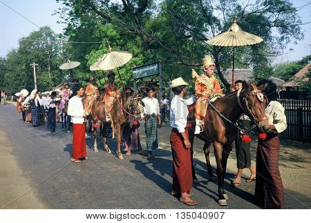 PAGAN / MYANMAR - CIRCA 1987: Small children in elaborate regal costumes ride on horseback in a Buddhist parade in Pagan during a holiday.