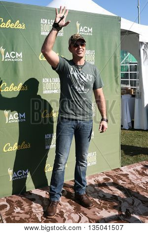 ARLINGTON, TX - APR 18: Recording artist Lucas Hoge attends the ACM & Cabela's Great Outdoor Archery Event at the Texas Rangers Youth Ballpark on April 18, 2015.