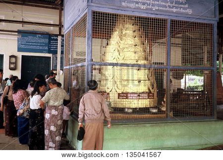 PAGAN / MYANMAR - CIRCA 1987: Worshippers enter the Shwezigon Pagoda in Pagan.