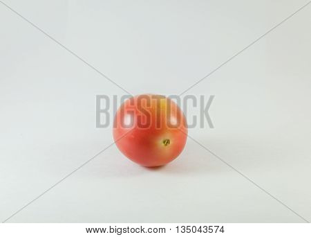 a glossy red, or occasionally yellow, pulpy edible fruit that is typically eaten as a vegetable or in salad.