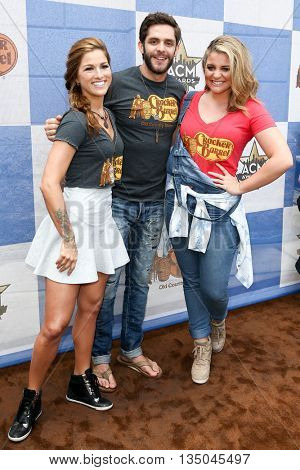 ARLINGTON, TX - APR 18: (L-R) Cassadee Pope, Thomas Rhett and Lauren Alaina attend the Cracker Barrel Country Checkers Challenge at Globe Life Park in Arlington on April 18, 2015 in Arlington, Texas.