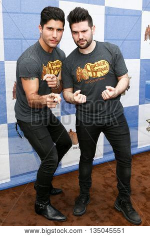 ARLINGTON, TX - APR 18: Dan Smyers (L) and Shay Mooney of Dan + Shay attend the Cracker Barrel Country Checkers Challenge at Globe Life Park in Arlington on April 18, 2015 in Arlington, Texas.