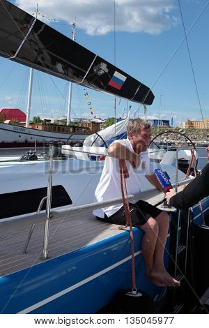 ST. PETERSBURG, RUSSIA - JUNE 4, 2016: Skipper Sergey Borodinov at the yacht Bronenosec of Russia talks with press before the opening ceremony of the Nord Stream Race. Five teams compete in the race