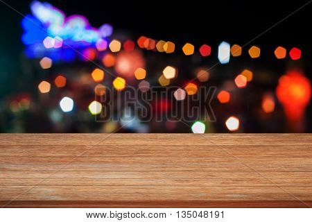 Wooden tabletop with abstract blurred lights, stock photo
