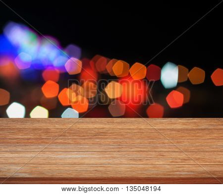 Wooden tabletop with abstract night lights, stock photo