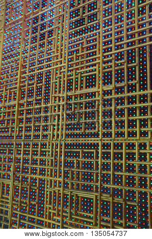 Abstract pattern of golden steel tube with light emitting diode background