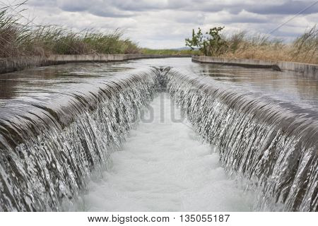 Floodgate area at huge irrigation canal of High Guadiana or Vegas Altas Extremadura Spain poster