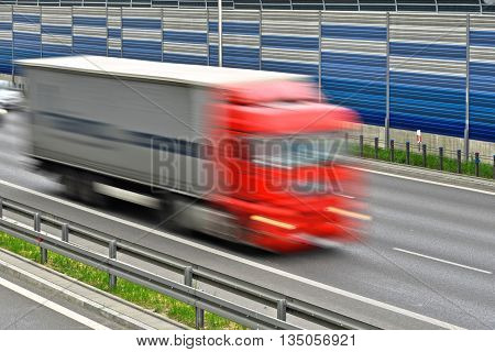 Large Goods Vehicle Moving At Full Speed On Six Lane Highway