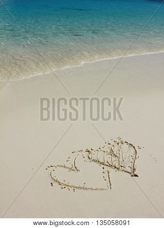 Heart shapes on white sand beach, love concept