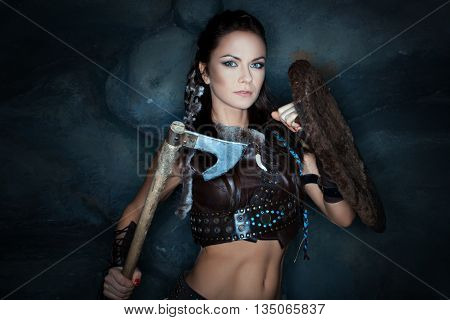 Medieval woman with an ax in his hand she amazon warrior.