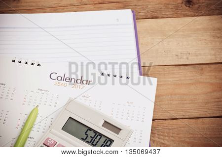 Calculator and calendar put on the note book for business background