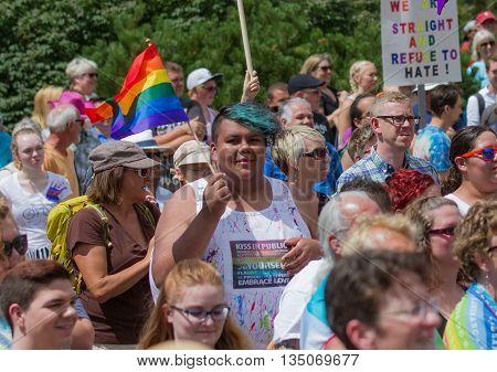 Boise, Idaho/usa - June 20, 2016: Man Proudly Waving His Flag During The Boise Pridefest Parade