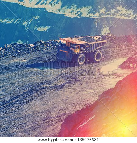 working truck in career on extraction of minerals