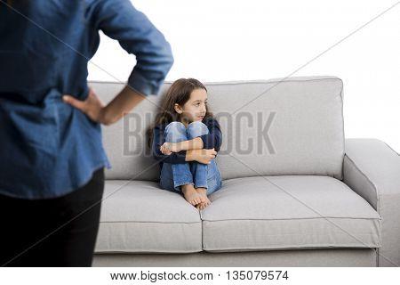 Grown up rebuking a little child for bad behavior