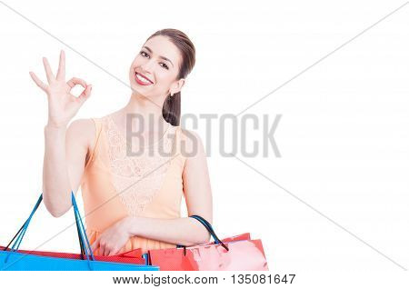 Woman Holding Shopping Bags Showing All Right Gesture