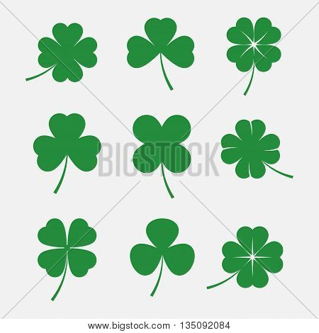 Clover leaves vector set isolated on white background. Silhouettes of four and three leaf clover. Lucky leaf clover in flat stle.