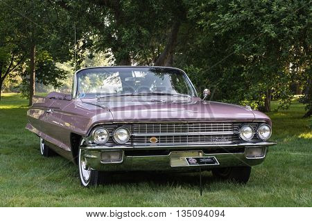 GROSSE POINTE SHORES MI/USA - JUNE 19 2016: A 1962 Cadillac car at the EyesOn Design car show, held at the Edsel and Eleanor Ford House, near Detroit, Michigan.