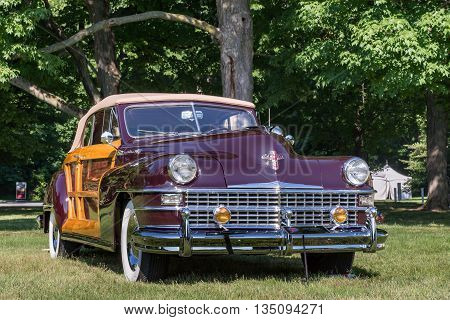 GROSSE POINTE SHORES MI/USA - JUNE 19 2016: A 1948 Chrysler Town & Country car at the EyesOn Design car show, held at the Edsel and Eleanor Ford House, near Detroit, Michigan.