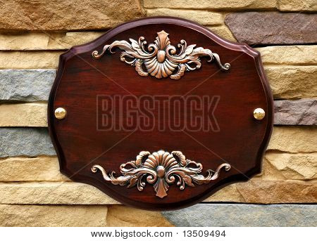wood signboard on stone wall