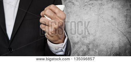Business employee squeeze crumpled paper in hand, on concrete texture background with copy space