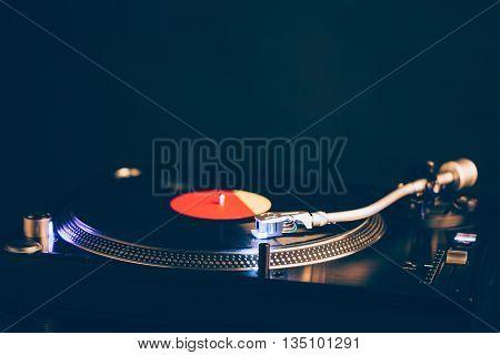 professional dj turntable with illumination, dark background