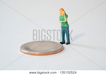 Little Person Thinking About Money by a Coin