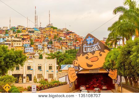 Guayaquil Ecuador - April 15 2016: Panoramic view at the cell phone towers and colorful houses of Guayaquil's Cerro Santa Ana neighborhood.