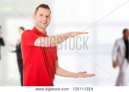Excited man showing copy space