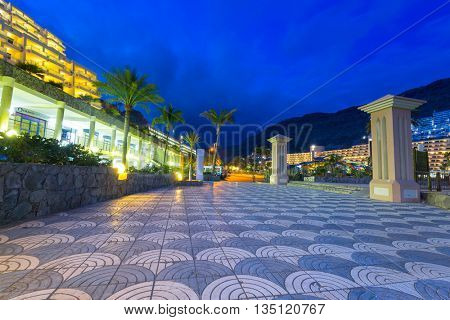 TAURITO, GRAN CANARIA, SPAIN - APRIL 20, 2016: Beach and resort complex in Taurito at night, Gran Canaria island, Spain. Taurito is very popular tourist destination on Gran Canaria.