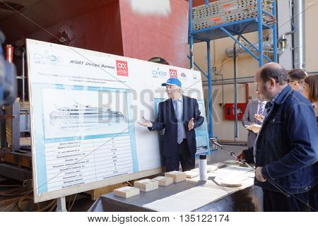 ST. PETERSBURG, RUSSIA - MAY 24, 2016: General director of Sredne-Nevsky shipyard Vladimir Seredokho make presentation of the production of his enterprise. The shipyard was founded in 1912