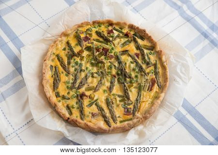Home made quiche with asparagus, cheese and peas