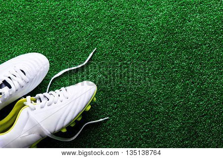 White Cleats Against Green Artificial Turf, Studio Shot