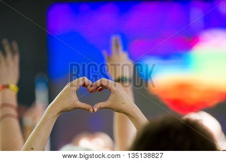Boise, Idaho/usa - June 20, 2016: Person Holding Up Their Hands In The Shape Of A Heart During The Q