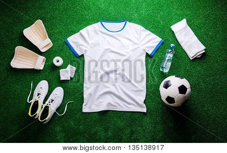Soccer Ball,cleats And Various Football Stuff Against Artificial
