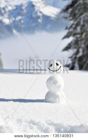 Snowman against Alpine scenery