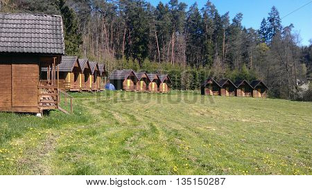 Summer camp, wooden huts between forests, before the first visitors. In czech rep.